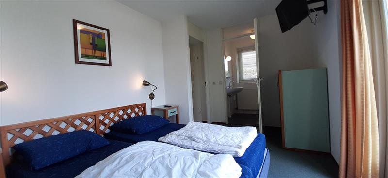 Vakantiehuis te koop Bruinisse Zeeland slaapkamer beneden