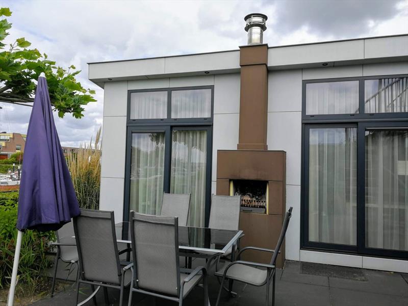 Vakantiehuis te koop in Dordrecht terras met openhaard